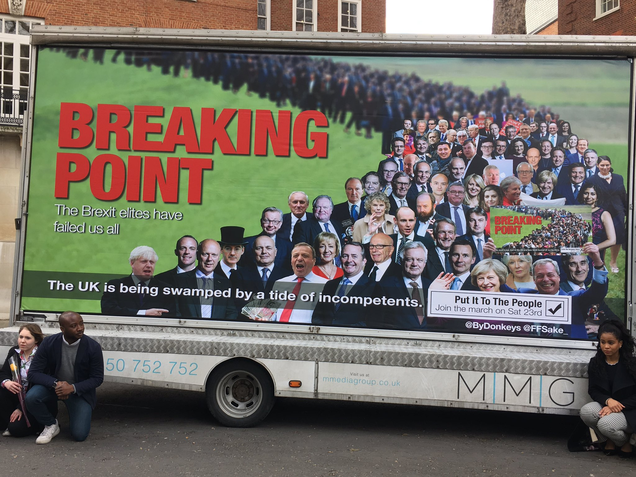 Image of a billboard on the side of a van. The poster is of an altered pro-Brexit poster.